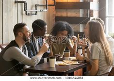 Multiracial happy young people eating pizza in pizzeria, black and white cheerful mates laughing enjoying meal having fun sitting together at restaurant table, diverse friends share lunch at meeting Dinner Reservations, Eat Together, Time To Move On, People Eating, Restaurant Tables, How Many People, Significant Other, Try Harder, Young People