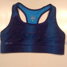 NWT Navy Galaxy Printed Sports Bra NWT Navy/Light Blue Galaxy printed Nike Dri-fit sports bra                                                    •Navy swoosh in perfect condition                               •Size Extra Small                                                            • Highly sought out pattern Nike Tops