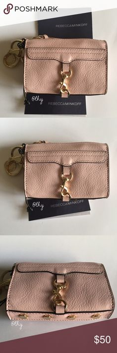 """REBECCA MINKOFF MINI MAC KEY FOB WALLET Authentic NWT Rebecca Minkoff Mini MAC Key Fob wallet. """"Baby Pink"""" leather w/ light gold hardware. Zip top closure. Approx 4.5""""W x 3""""H x 1.25""""D. Key clip attached with logo disc charm. Signature style scaled down. Makes for great bag charm or small wallet accessory. Conveniently fits ID, cards and cash. Reasonable offers will be considered only when submitted using the make offer feature ❌❌NO TRADES NO PP NO EXCEPTIONS❌❌ Rebecca Minkoff Bags Wallets"""
