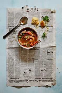 Food Styling- I like how the newspaper adds a certain at home feel, pairing that with comfort food.  Winter Warmers: Seafood and Sausage Gumbo At the dawn of winter, we crave soup. As the season...