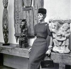 Elegant sapphire-blue wool dress by Jean Patou, hat by Jean Barthet, brooch by Casty, gloves and bag by Hermès, 1959