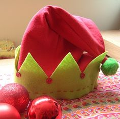 Elf Hat.... Idea: Make kids honorary elves for one day to help Santa... kids can help prepare for christmas around the house or give gifts to needy kids
