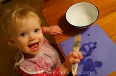 Water painting - 21 Activities for One Year Olds - Baby Play - Wildflower Ramblings