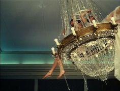 film still of chandelier scene from Sedmikrasky (Daisies)
