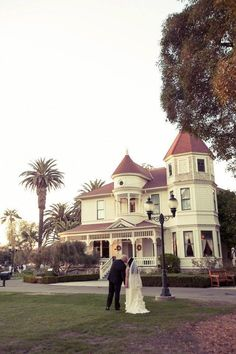 #camarilloranch bride and groom on the main lawn facing Adolfo's 1892 Queen Anne Victorian home.