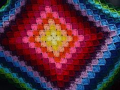 Rainbow colored blanket.  Looks hard, but maybe I'll be able to do it in a few years