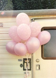 this not only has pink balloons but a vintage trailer! This looks like my 1989 King of the Road that I am going to glamp out this next year! :-)
