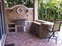 custom outdoor kitchen built in bbq grill island with backsplash and dry stack ledge stone — Gas Grills, Parts, Fireplaces And Service Bbq Grill Island, Built In Bbq Grill, Diy Grill, Grill Area, Built In Outdoor Grill, Outdoor Kitchen Countertops, Concrete Countertops, Barbecue, Outdoor Barbeque
