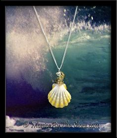 "Bright crisp white & lemon yellow Hawaiian Sunrise Shell with accenting Citrine gemstones necklace! This Sunrise Shell is a perfectly gorgeous top shell with bumpy, ruffled ribs, measuring 1"". The seashell pendant drapes from an 18"" sterling silver curb chain necklace. Perfectly beautiful detail in this shell! Get ready for compliments! See the matching pair of earrings on the EARRINGS page! These shells are such a rare color it was a joy to find three shells that matched so perfectly!"