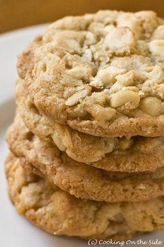 White Chocolate Macadamia Cookies:  1 cup (2 sticks) unsalted butter, softened  1 1/2 cups granulated sugar  1 cup brown sugar, packed  2 eggs, room temperature  1 1/2 teaspoons vanilla extract  3 cups unsifted flour  1/2 teaspoon baking soda  1 teaspoon salt  2 cups (11 oz. bag) white chocolate chips  1 1/2 cups Macadamia nuts, chopped