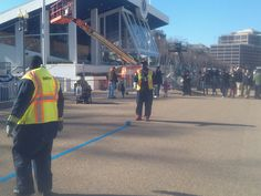DDOT crew laying down the temporary blue tape as the official Parade Route marker for the President's walk