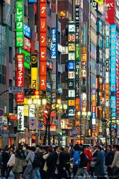 Japan, Tokyo, Shinjuku, Neon advertising signs in street