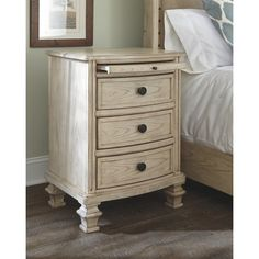 There's nothing like vintage-inspired style to make you feel at ease. Case in point: this nightstand. Bathed in a parchment white dreamy finish with gently distressed accents and elegantly turned details, it's got all the makings for a beautifully restful retreat. A pull-out tray provides added surface space while electrical outlets with USB charging stations are great if you love bringing your laptop to bed.