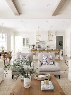 Open layout living room and kitchen, Benjamin Moore classic gray, white kitchen, wood beams, brass l Farmhouse Style Kitchen, Modern Farmhouse Kitchens, Kitchen Wood, Farmhouse Decor, Kitchen Island, Kitchen Decor, Living Room Furniture, Living Room Decor, Home Furniture