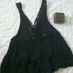 Lace Free People Top Be in style with this black lace tank top from Free People. Never worn. Free People Tops Tank Tops