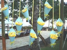 The flower cone with frangipani flowers, and ribbon as the hanger.