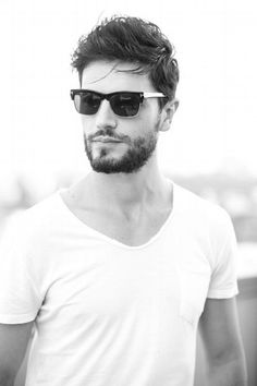 Rugged look.  White T and Tom Ford sunglasses