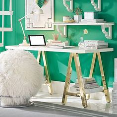 love this A frame desk. the gold legs make it a bit glam but it's also really functional. putting trays on the legs is such a clever idea as a way to display books.  *and logan likes this too!
