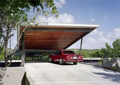 The roof of the carport extends out in a grand, modern gesture of welcome to the driver coming home.