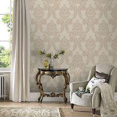 A super textured durable expanded vinyl featuring a Grand Damask wallpaper design and the Renaissance design as a background. In neutral cream tones  gilded with gold glitter highlights and a textured finish. Perfect for covering up minor wall imperfections and blemishes as the 3 dimensional finish helps to disguise lumps and bumps and also makes it easier to decorate with. This product is peelable so when it is time for a change the removal process is easier. Use alone on all 4 walls or as…