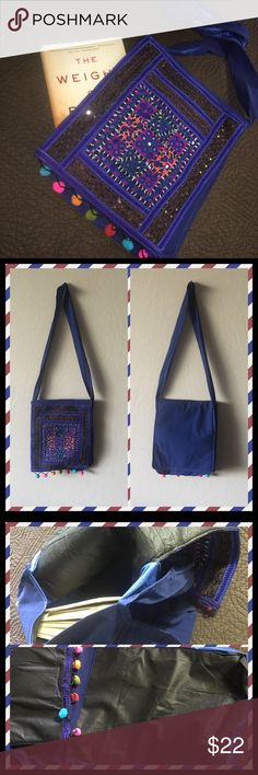 NWOT Navy Boho Shoulder Bag NWOT Navy bag has detailed stitching with brightly colored Pom poms across the front fold over flap.  Zip pocket shown, a book can fit inside.  Cell phone pocket, roomy inside, very lightweight fabric.  Long shoulder strap provides an easy cross body wear as well.  Unique, stylish, easy.  Imported. Bags