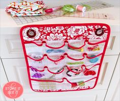 Hanging Sewing Caddy with Clear-View Vinyl Pockets: Janome Skyline S7 | Sew4Home