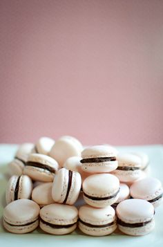 Strawberry flavoured macarons with strawberry-infused chocolate ganache filling.