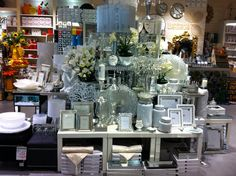 Habitania Blacktown. Soft, Silvery and Feminine. Silver Frames in various sizes, lamps and white flowers and silver candle sticks.
