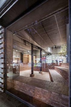 parallel café in central beijing is clad with red bricks, by temp Brick Cafe, Landscape Bricks, Modern Cafe, Long Bench, Grey Brick, Brick Design, Old Building, Terrace Garden, Steel Structure