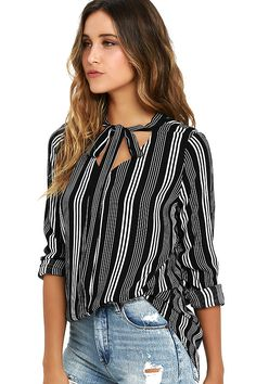 You're a trendsetter by nature, which is why you and the Fashion Influencer Black Striped Long Sleeve Top make perfect sense! Light and gauzy woven rayon is a dream as it shapes long sleeves (with button cuffs) and a tying neckline. Rounded hem. As Seen On Olivia of @oliviarink!
