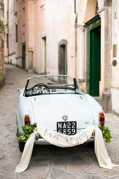 vintage wedding getaway car / http://www.himisspuff.com/ways-to-decorate-your-wedding-getaway-car/5/