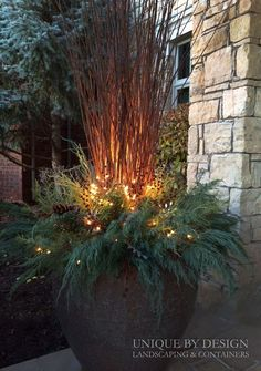 Outdoor winter holiday container. Green boughs, twinkle lights.