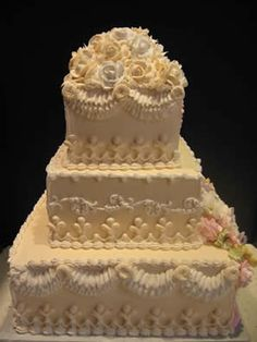 Harriet's Creations/ all buttercream w royal icing flowers and scrolls