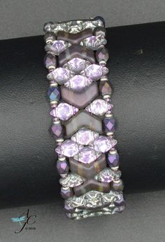 Use 2 hole Chevrons and DiamonDuos to weave this striking cuff bracelet named Marquee - PDF Beading Pattern by AndreaCatherineJewel on Etsy Bead Embroidery Patterns, Bead Crochet Patterns, Beaded Bracelet Patterns, Beaded Embroidery, Beading Patterns, Knitting Patterns, Mosaic Patterns, Color Patterns, Art Patterns