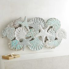 Your coastal home celebrates all things aquatic, and these souvenirs of the sea form a sculptural art piece that sparkles with glass and mirror detailing. Coastal Wall Art, Coastal Decor, Coastal Style, Coastal Living, Accent Wall Panels, Wall Accents, Accent Walls, Coastal Bathrooms, Am Meer