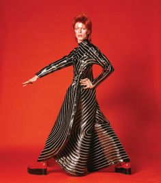 """Purchase this 1973 David Bowie print by Masayoshi Sukita from Morrison Hotel Gallery. This bold print is from David Bowie's """"Watch That Man"""" photoshoot. Angela Bowie, Brian Duffy, Bowie Ziggy Stardust, David Bowie Ziggy, David Bowie Dress, David Bowie Costume, David Bowie Starman, Iggy Pop, Glam Rock"""