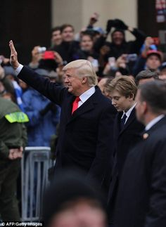 The newly sworn-in president leads his son down Pennsylvania Avenue for the Inaugural Para...
