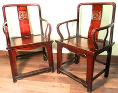"""This pair of Antique Chinese Arm Chairs is made in simple yet elegant Ming style. Traditional Chinese """"dragon"""" design ornately carved on the back splat of the chairs. The relief carvings are highlight"""