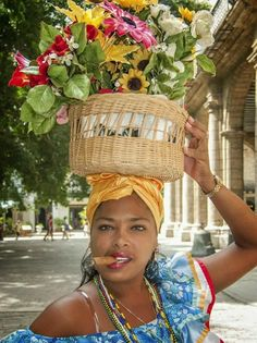 Cuban Lady With Flowers by Istvan Juhasz