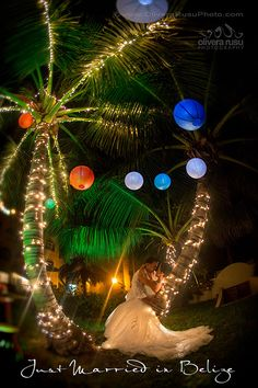 Our Wedding in Caribbean: Best Day Ever! at Grand Caribe, Belize, lanterns and lights on coconut trees, island beach reception.
