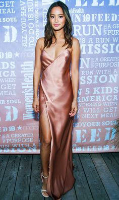 in a blush-toned Michelle Mason silk slip dress with a thigh-high slit, plus white Stuart Weitzman sandals, at the Women's Health Party Under the Stars event in Bridgehampton, New York (aug 2016)