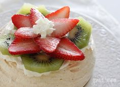 Strawberry Kiwi Pavlovas - Pavlovas are elegant yet light, made with whipped egg whites and sugar, then topped with cream and fresh fruit. The perfect light dessert!