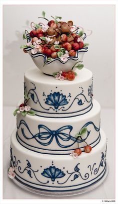 The cherries are made out of marzipan, the mice out of fondant, and the blossoms out of gumpaste. The blue embroidery piping is supposed to resemble traditional french china.