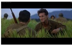 Terence Malick : The Thin Red Line. The framing of this shot with the pale blue sky, dusty mountains and grass that surrounds the actors create a striking image with great composition and frame. Grass, Composition, Language, Sky, Actors, Mountains, Create, Blue, Fictional Characters