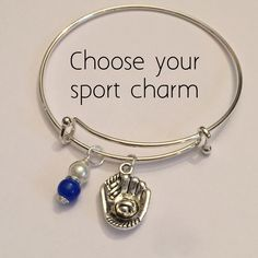 A personal favorite from my Etsy shop https://www.etsy.com/listing/229127641/sports-charm-bracelet-senior-gift-add-a
