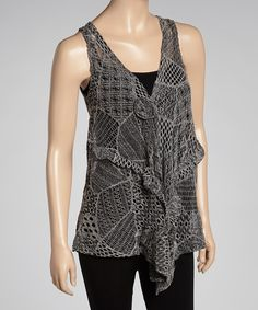 It never hurts to add a little charm to an ensemble. This crocheted vest includes a coy tie closure that keeps the ensemble bundled and the wardrobe stylish.Fits sizes 0 to 12Measurements: 28'' long from center back neckline to hem65% cotton / 35% polyesterHand wash; hang dryImported