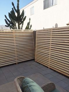 Wood slat walls used to improve the look of a small rental home patio