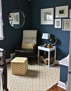 This blue shade of charcoal paint is beautiful. I always thought that a dark blue/grey wall would make a room look cold, but it really is amazing. I love the box frames of the pictures on the wall too.