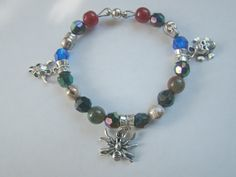 Tibetan Silver charms, 1 spider and 2 different skulls, bracelet with a magnetic clasp, available in my shop