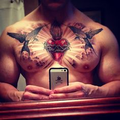 Chest piece complete. #swallow #swallows #barnswallows #sacred #heart #sacredheart #sunburst #clouds #tattoo #chesttattoo #inked. Done by the amazing @ericmarcinizyn. by QwaktastiK, via Flickr